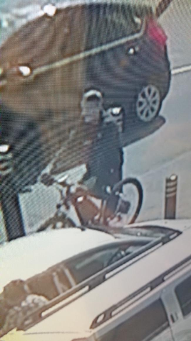Police want to speak to the man after a bike was stolen from Asda in Clayton Brook
