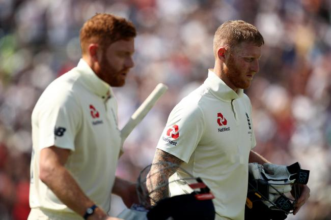 England's Ben Stokes (right) and Jonny Bairstow (left) walk off for lunch during day four of the third Ashes Test match at Headingley