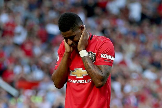 Manchester United's Marcus Rashford appears dejected after missing from the penalty spot