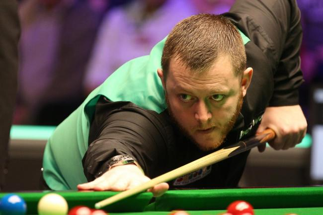 Mark Allen came through in a final frame decider against Nigel Bond at the UK Championship
