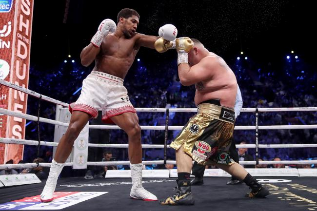 Anthony Joshua (left) regained his titles