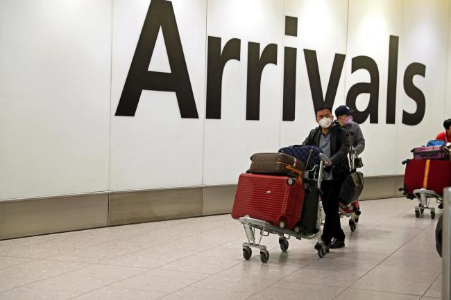 Passengers in the arrivals concourse at Heathrow Terminal 4