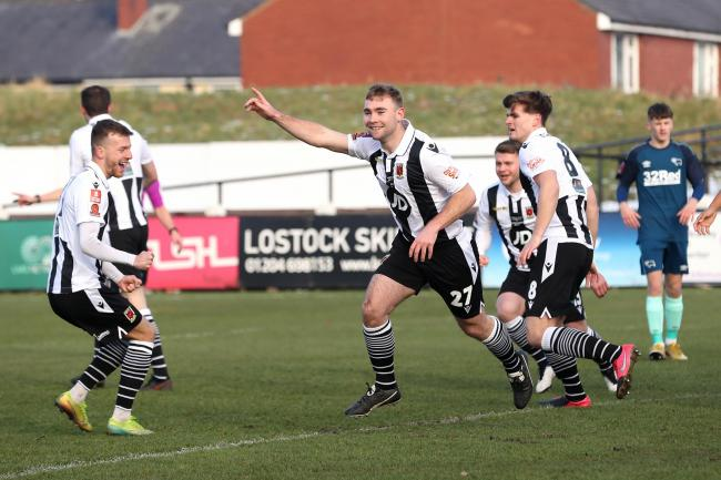 Chorley's Connor Hall celebrates opening the scoring against Derby in the third round