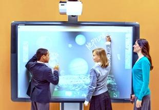 Chorley Citizen: FINGERTIP CONTROL: Two pupils demonstrate  accessing the internet on the ActiveBoard 500 interactive whiteboard at Bett 2011
