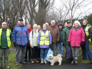 Councillor John Walker and his dog join walkers and walk leaders at the start of the new Adlington Find Your Feet Health Walk
