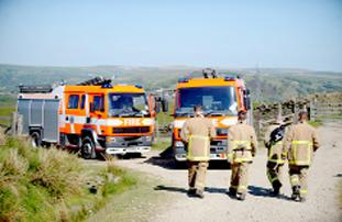WORKING HARD Firefighters on moors in Bacup