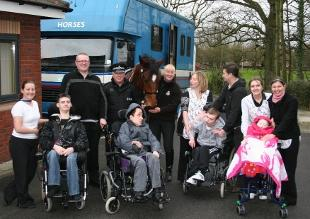 NEW FRIENDS: PC Adrian Phillips and Elaine Wadeson from Lancashire Constabulary with Gisburn and children and staff from Derian House