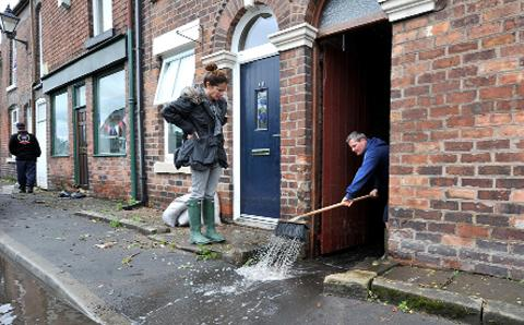 Residents clean up after floods in Croston