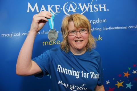 GIVING BACK: Janet Davies with her medal