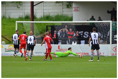 MATCH ACTION: Hednesford's keeper at full stretch saves a Chorley effort on goal. Picture: ROB GREGSON