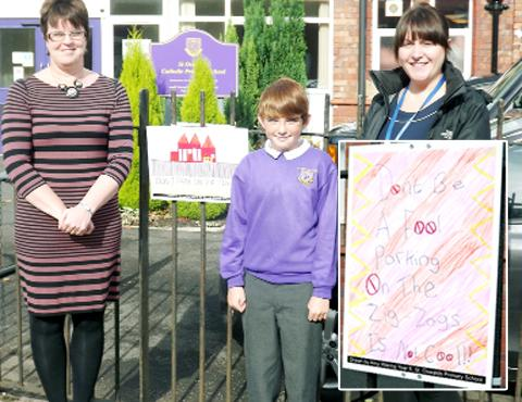 Mrs Green, year 6 winner James Fox, and PCSO Liz Coleman. Inset: Amy's winning poster