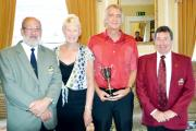 Shaw Hill president David Heywood, Jennifer Culshaw, competition winner Ken Page with his trophy, and club captain Kevin O'Brien