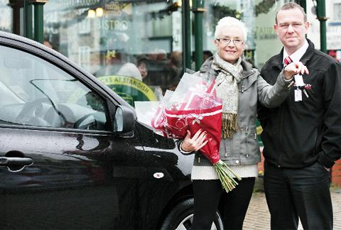 Margaret Fairhurst receives the car keys from Guy Keegan, of Chorley Nissan