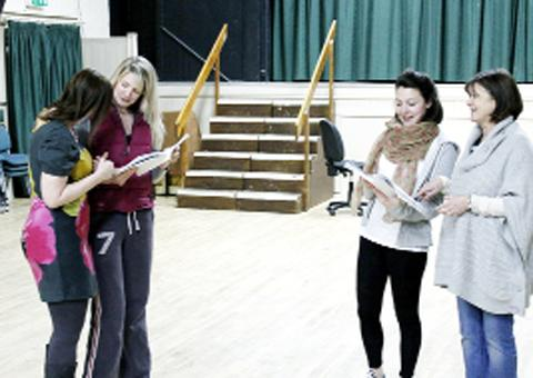 The cast of The Wedding Singer in rehearsal