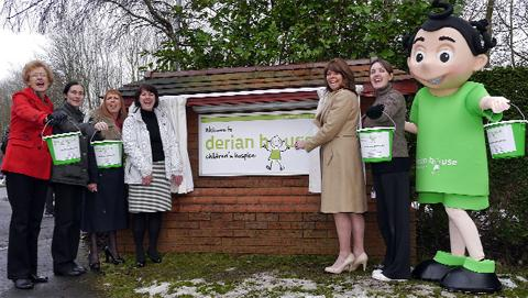 Georgina Cox (third from right), chair of the hospice trustees, unveils the new signage, with, from left, volunteer Jane Lord, Lisa Lord of the care team, fund raising manager Susie Poppitt, general manager Andrea Cail, volunteer Nicola Hailwood and 'De