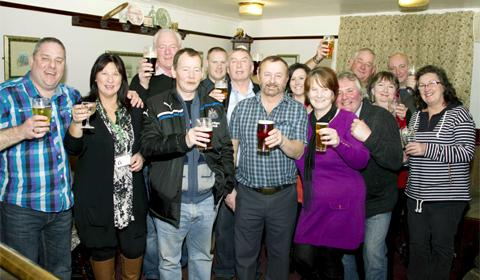 Denise Potter from The Potters Arms (sixth from left) wth staff and customers