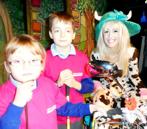 Amy and Ben Wright meet Pat the Cow at the Playhouse Theatre