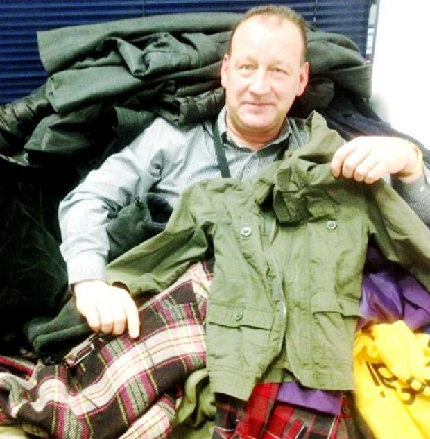 Peter Woods from Adactus Housing Group with some of the coats he has collected