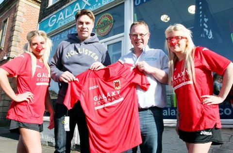 Chorley Manager Garry Flitcroft with Mark Parr from sponsors Galaxy Football and Heather Charnley and Beth Hartley modelling the new third kit which will be unveiled on Saturday
