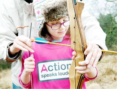 SHARP SHOOTER: Amy Wright, six, from Euxton, tries her hand at archery