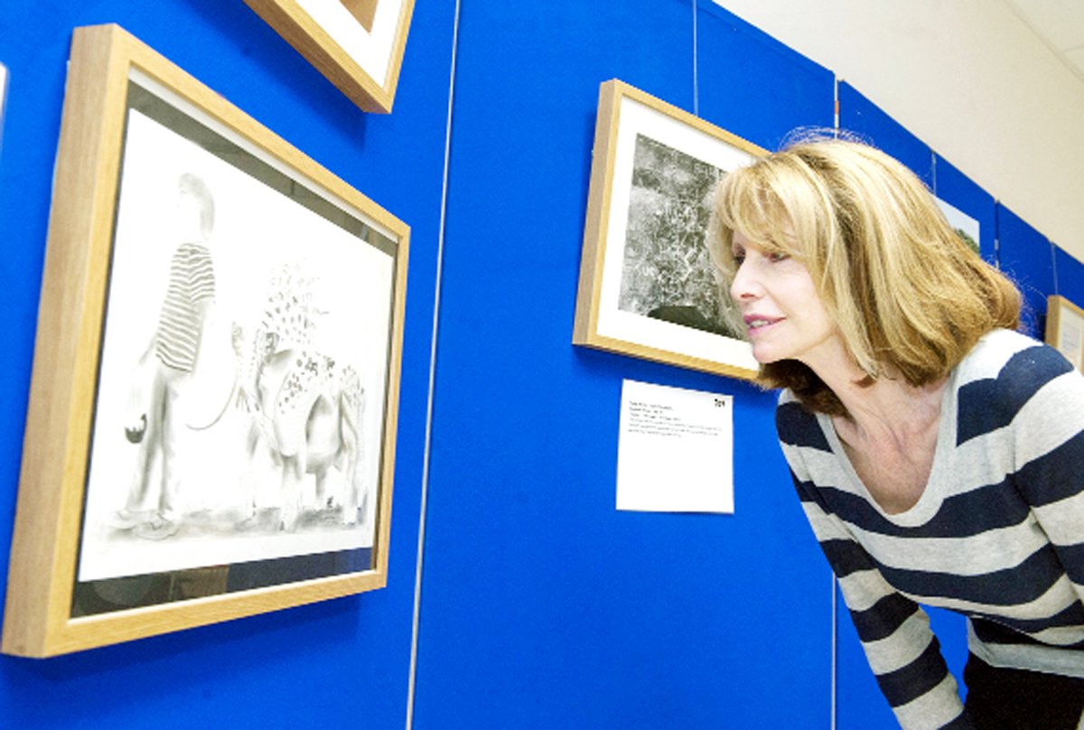 Judge Jane Asher admires one of the works