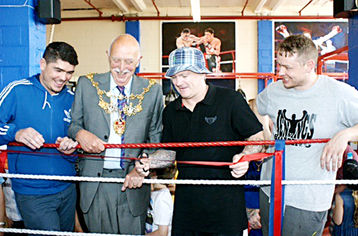 Chorley boxer Michael Jennings welcomes the Mayor, Coun John Walker, Ricky Hatton and Dave Jennings to the opening of his gym