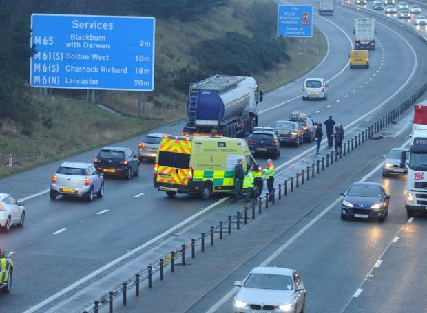 Collision causing long tailbacks on M65 near Blackburn