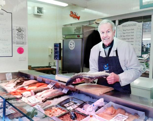 Peter Livesey prepares to fillet his last salmon