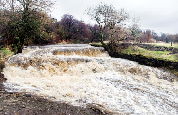 Pendle Water at Ball Grove Park, Trawden has been swollen by heavy rain
