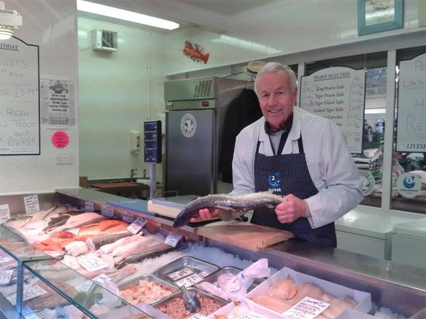 Peter gets ready to fillet a whole salmon on his final day at the stall