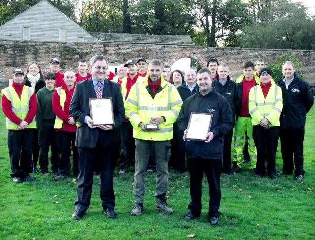 TEAM WORK: Coun Adrian Lowe, left, with Chorley Council Streetscene operative Paul Marsh, centre, and assistant manager Sean Blake, with the certificates and trophy from North West in Bloom 2013. Council staff involved in helping the borough bloom look on