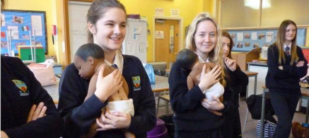 LESSON IN CARING: Albany Academy pupils with their 'babies'