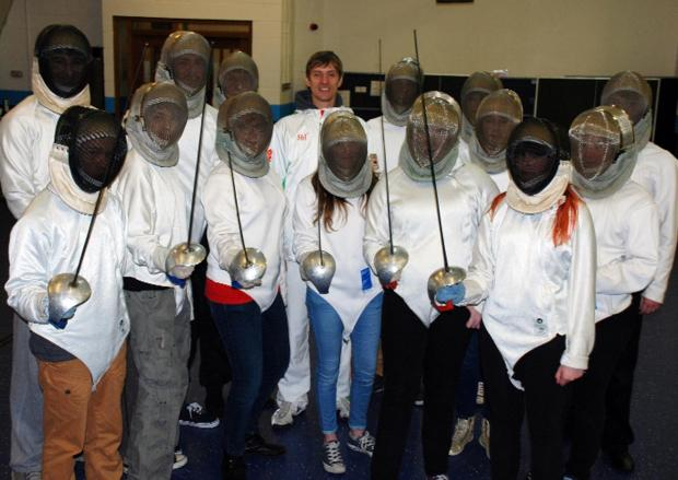 EN GARDE: Olympian and world fencing champion Dmitry Lapkes, who teaches at Rivington Park Fencing Club in Chorley, surrounded by the Winstanley College sabre fencing group