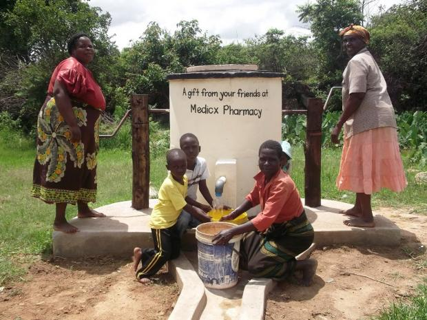 'huge difference': Villagers at the pump in Zimbabwe