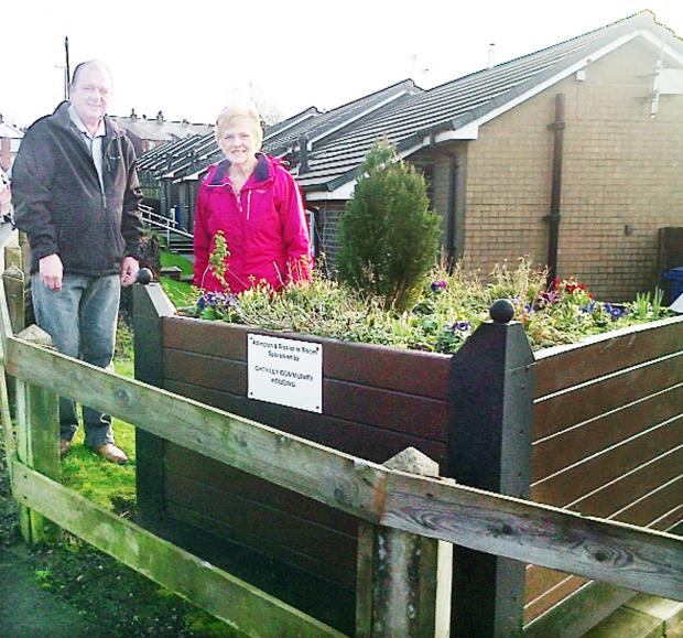 NEW PLANTER: Jeanette Lowe and Steve Higgins from the Adlington in Bloom group at the Rawlinson Lane site