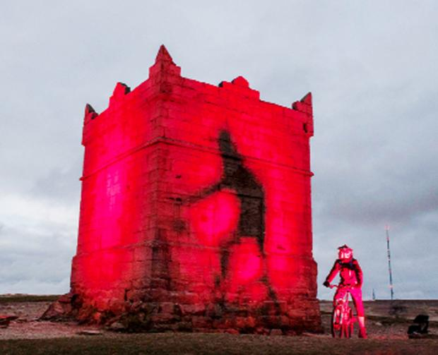 Rivington Pike glows rush-hour red. Picture: Martin Birchall