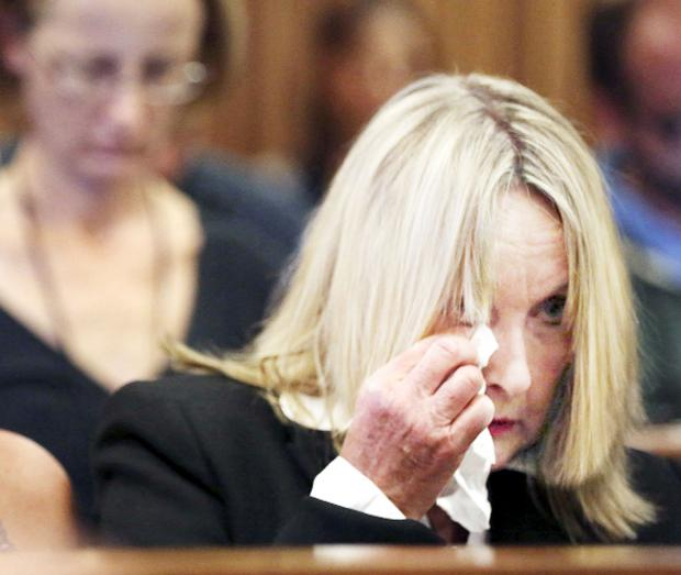 Chorley Citizen: June Steenkamp wipes away the tears as she listens to the evidence