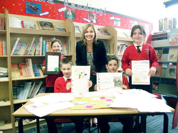 PEN PALS: Molly Bell, nine, Henry Ode, seven, Bradley Derbyshire, nine, and Bethany Smith Topping, ten, with headteacher at St Gregory's Primary School, Ros Wroblewski, with short stories written by the pupils