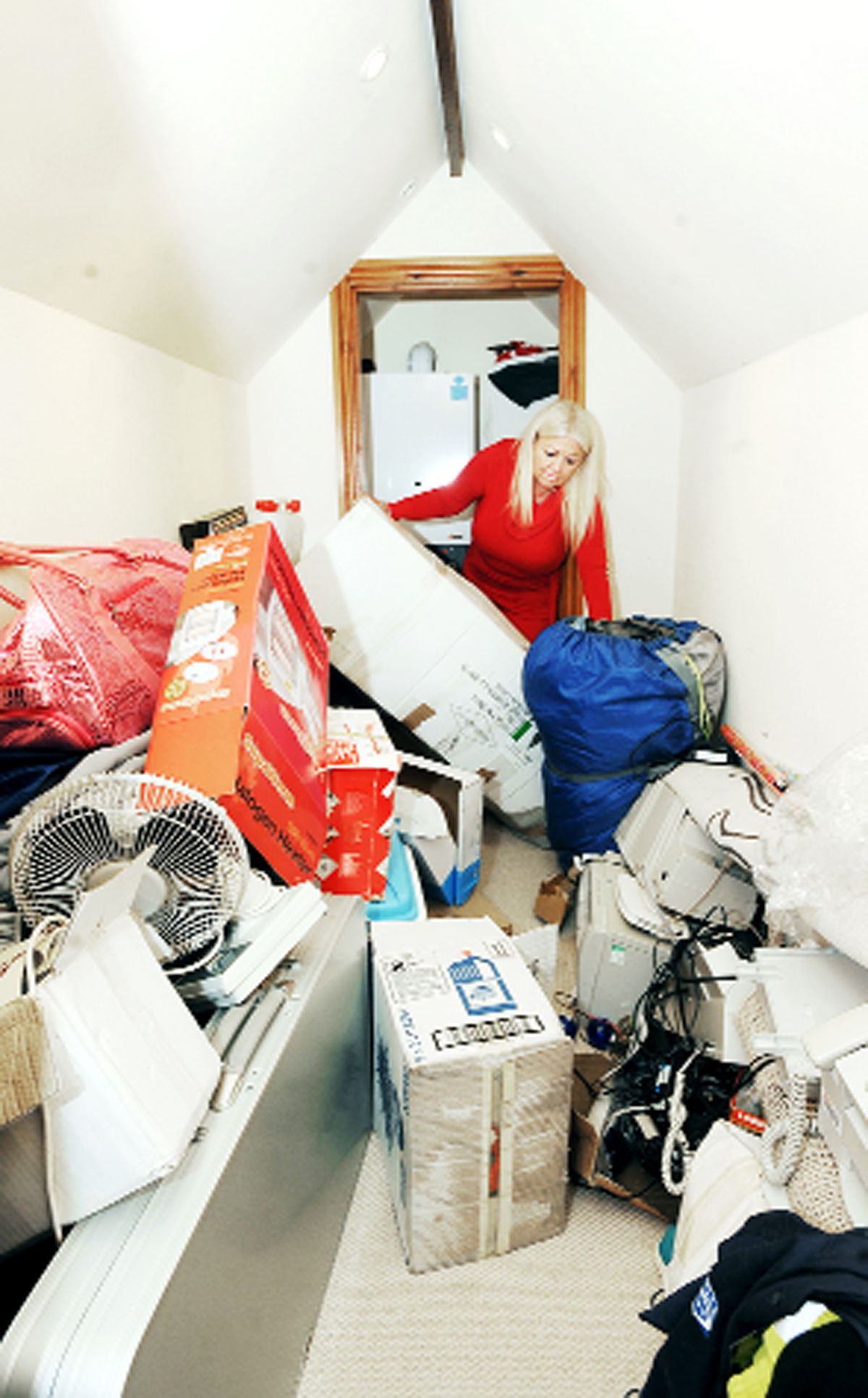 Julie Eastham in her Woodlea Chase home where she has suffered flooding after work on a boiler