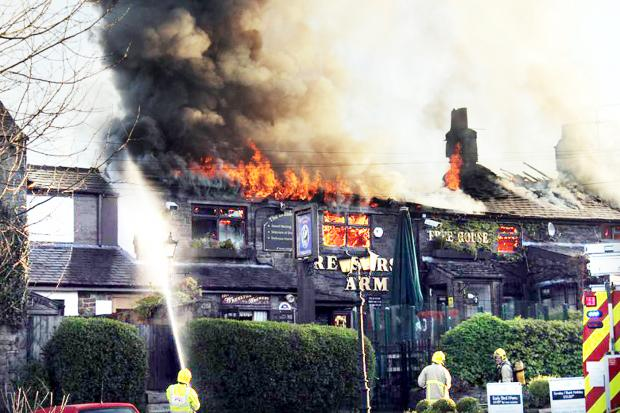 Chorley Citizen: DEADLY: Huge flames roar through the roof of the pub