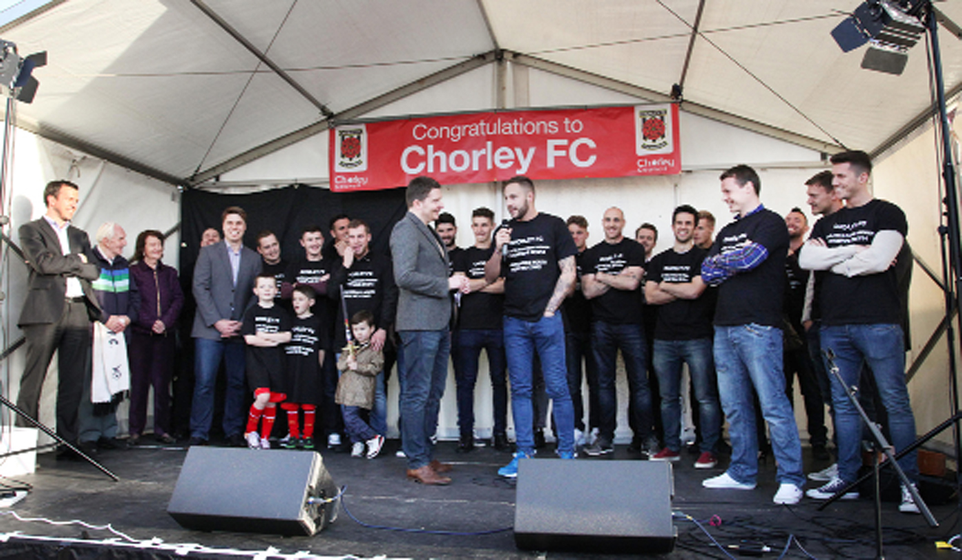 Fans celebrate with their local league heroes in civic reception