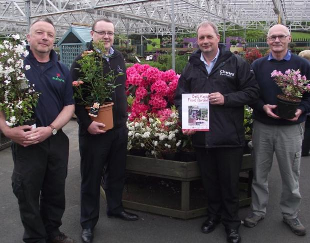 Chorley Citizen: GARDEN GURUS: From left, Steve Ainscough of Birkacre Garden Centre, CCH's Mike Murphy, Bob Webster of Chorley Council, and Dave Brown of of the gardening society