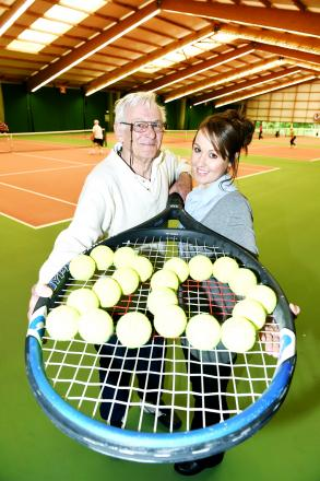 WHAT A RAQUET: Les Hood, who has been playing at South Ribble Tennis and Fitness Centre since it opened 20 years ago. is pictured with centre assistant Sarah Kennedy marking the anniversary