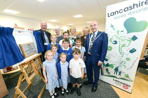 read it: From left, County Couns Marcus Johnstone and Jennifer Mein; branch manager Julie Baxendale, Diane Scarborough, district manager; County Coun Kevin Ellard, and pupils from Eccleston Primary School