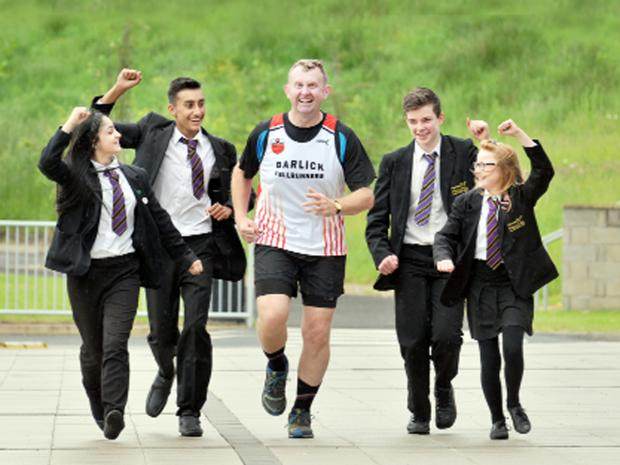 Deputy head James Stead is cheered on by students at Marsden Heights, Nelson