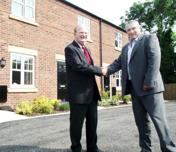 Coun Graham Dunn, left, congratulates Paul Lees from Adactus on the completion of homes for rent in Clancutt Lane, Coppull.