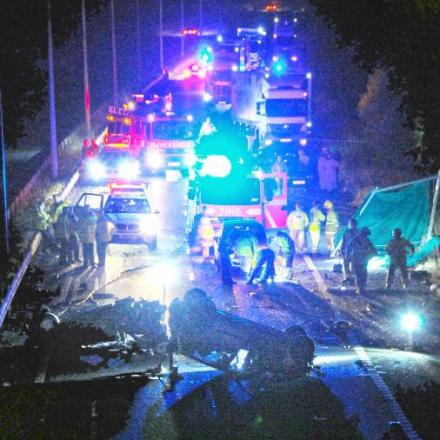 Emergency crews at the M65 crash scene where two men died after two cars ended on their roofs Picture IAN THOMPSON