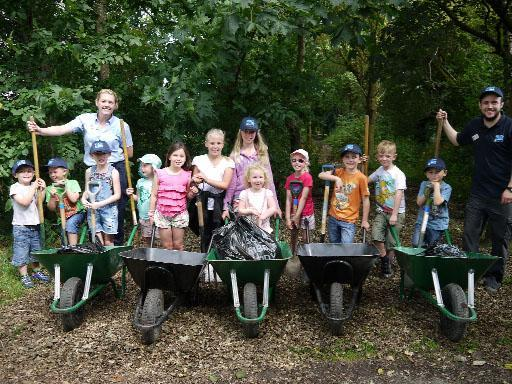 KIDS STUFF Children with rangers from South Ribble Council roll out their wheelbarrows in Withy Grove Park