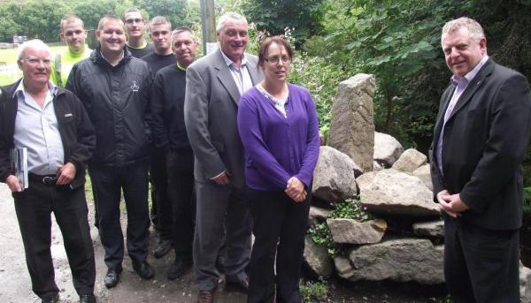 MEMORIAL: Coun Bev Murray and Paul Lees, chief executive of Adactus (parent company of CCH), centre, with resident Peter Pennington, left, Richard Houghton, director of operations at CCH, right, Chris Richardson and the CCH environmental hit squad who com