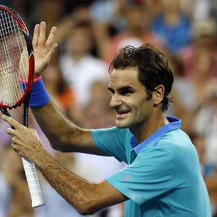 Slow-starting Federer hits top gear